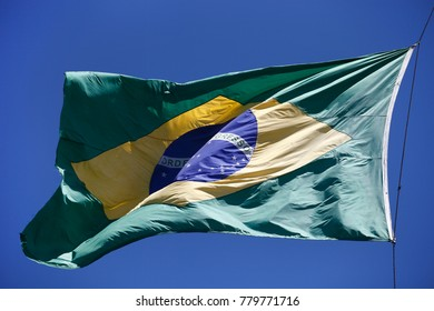 Flag of Brazil, blue green and yellow.