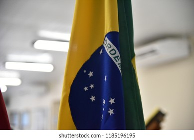 Flag of Brazil hoisted