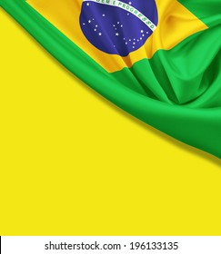 Flag of Brazil on yellow background. Clipping path for flag is included.