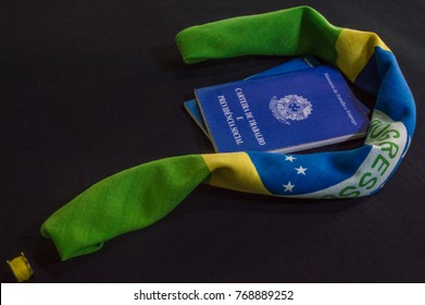 flag of the brazil and wallet of work  with the inscripition ministry of labour and employment republic of Brazil fifteen thousand november and eight hundred eighties and nine, wallet of work and soci