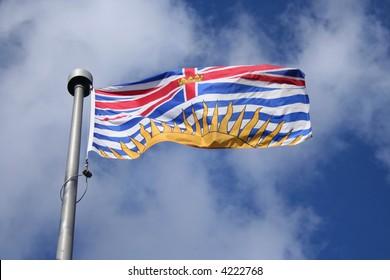 Flag of British Columbia against blue sky