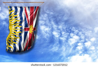 Flag of British Columbia. Vertical flag, against blue sky with place for your text