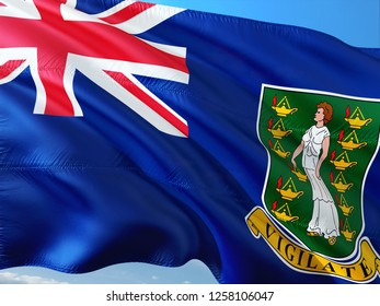 Flag of British Virgin Islands waving in the wind against deep blue sky. High quality fabric.