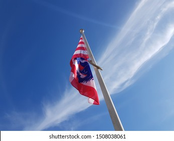 Flag of Bruges - Blue sky with cloud - Bruges, Belgium - Frog's eye view
