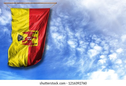 Flag of Burgenland. Vertical flag, against blue sky with place for your text