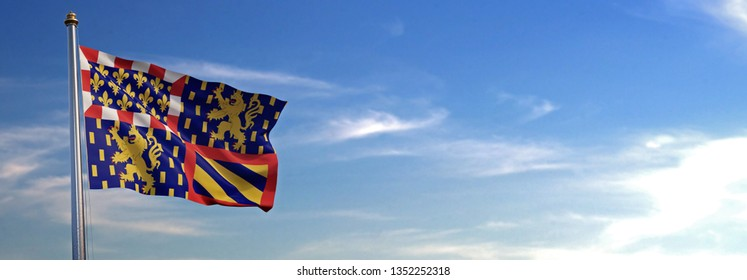 Flag of Burgundy-Franche-Comte rising in the wind with the sky in the background