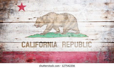 Flag of California painted on grungy wooden background