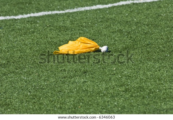 A flag is called on a play during an American football game.
