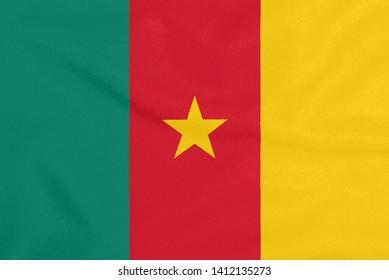 Flag of Cameroon on textured fabric. Patriotic symbol