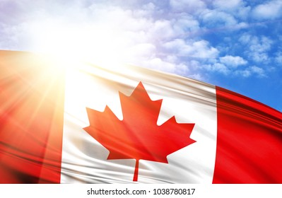 flag of Canada against the blue sky with sun rays