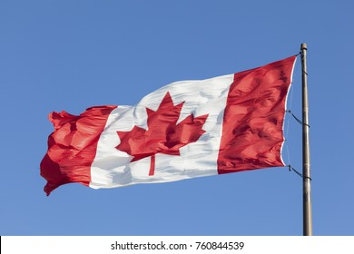 Flag of Canada against a blue sky