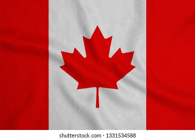 Flag of the Canada from the factory knitted fabric. Backgrounds and Textures