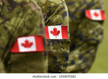 Flag of Canada on military uniform. Canadian soldiers. Army of Canada. Remembrance Day. Canada Day.
