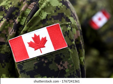 Flag of Canada on the military uniform. Canadian soldiers. Army of Canada. Remembrance Day. Poppy day. Canada Day.