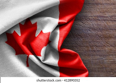 Flag of Canada on wood background