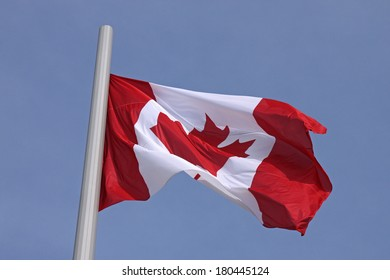 flag of Canada over blue sky
