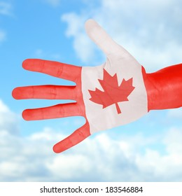 Flag of Canada painted on hand