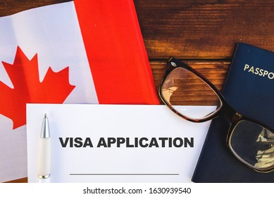 Flag of Canada, visa application form and passport on table