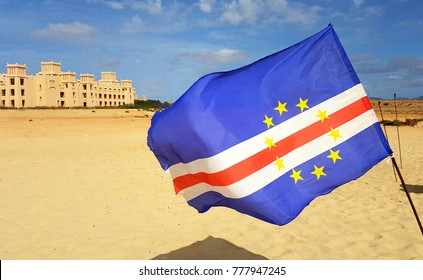 The flag of Cape Verde waves on a beach in Boa Vista