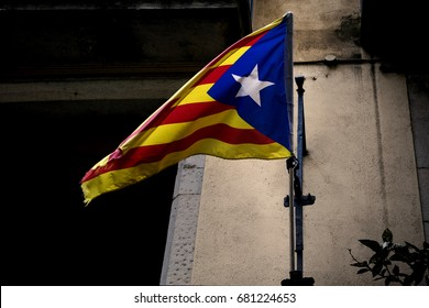 Flag Catalonia independence. The flag of independent Catalonia hangs on the balcony
