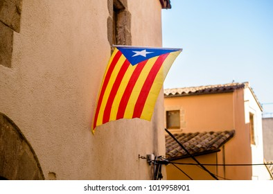 Flag of Catalonia on the street in Tossa de Mar, Spain