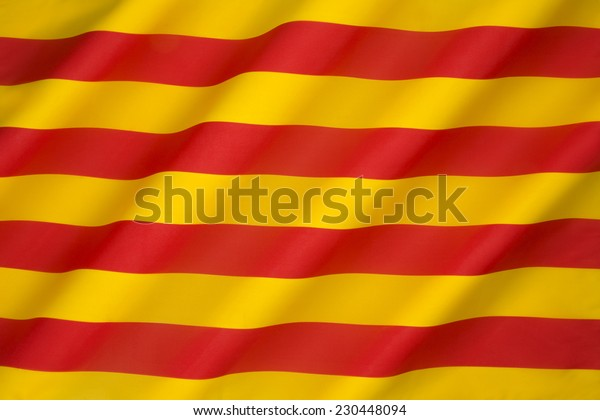 Flag of Catalonia - The Senyera. This flag, often called bars of Aragon, historically represented the King of the Crown of Aragon. Catalonia is a region of Spain.