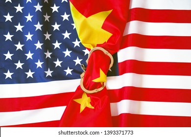 Flag of China in Handcuffs on the background of the flag United States of America. USA sanctions against China, chained handcuffs, political or economic conflict. The concept of sanctions.