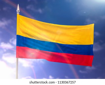 Flag of Colombia with flare and dark blue sky