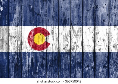 Flag of Colorado painted on wooden frame