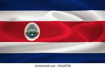 Flag of Costa  Rica waving in the wind. Silk texture pattern