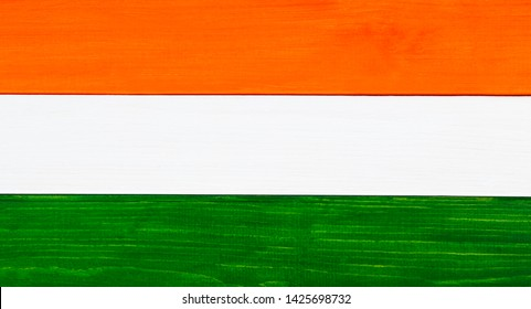 Flag of the country of India - tricolour flag, painted on rustic wood, as a natural design / banner / background.