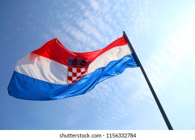 Flag of Croatia, blowing in the wind. Beautiful sky in the background.