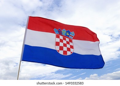 flag of Croatia fluttering in the wind in front of blue and white sky