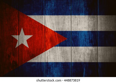 flag of Cuba or Cuban banner on wooden background