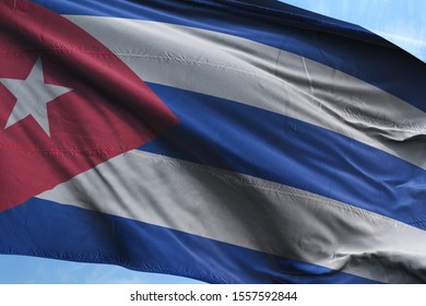 Flag of Cuba fabric waving in the blue sky. National Flag of Cuba for Independence day.