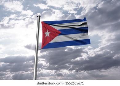 Flag of Cuba waving in the blue sky. National Cuba Flag on Pole.