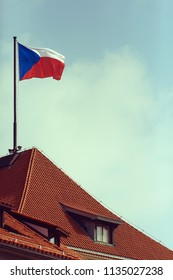 flag of the czech republic on the red roof