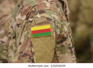 Flag of Democratic Federation of Northern Syria (DFNS) on soldiers arm. Flag of Democratic Federation of Northern Syria on military uniforms (collage).