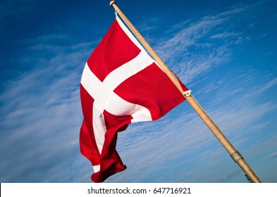 Flag of Denmark with Blue Sky Background