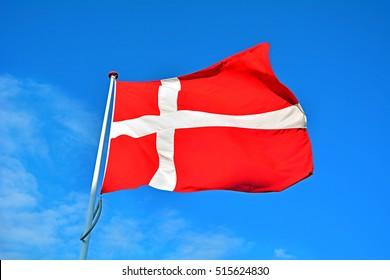 Flag of Denmark (called Dannebrog) waving on wind