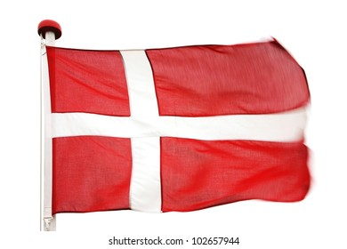 Flag of Denmark in the wind in front of an overcast sky