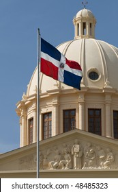 The flag of the Dominican Republic and the dome of the National Palace in the capital city, Santo Domingo.