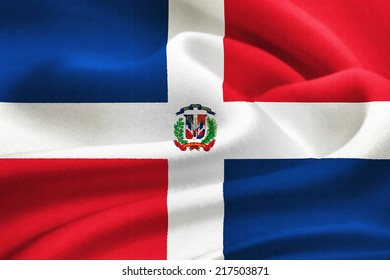 flag of the Dominican Republic waving in the wind. Silk texture pattern
