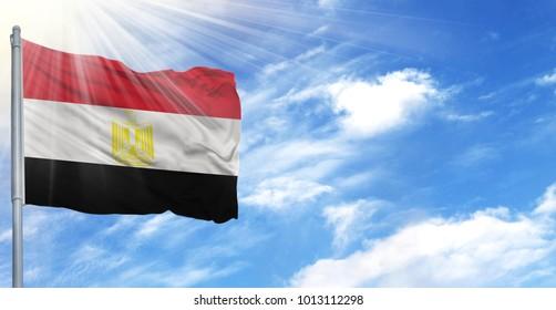 Flag of Egypt on flagpole against the blue sky