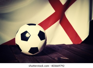 Flag of England with football on wooden boards as the background. Vintage Style. MANY OTHER PHOTOS FROM THIS SERIES IN MY PORTFOLIO.