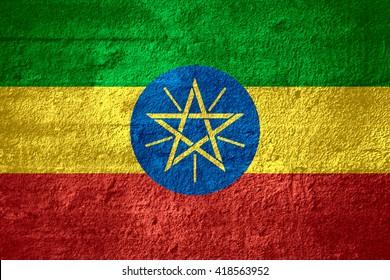 flag of Ethiopia or Ethiopian banner on rough texture