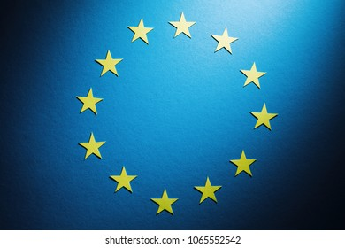 The flag of Europe (European Union) under dramatic light. Top view.