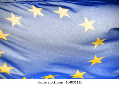Flag of Europe waving in front of the Reichstag building in Berlin, Germany