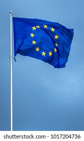 The flag of the European Union , against the background of the sunny sky. State symbols, politics.
