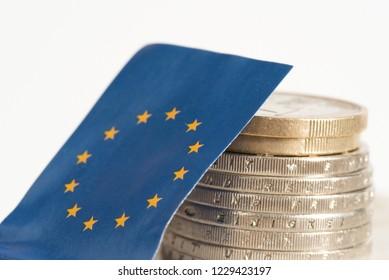 Flag of European Union EU and Euro coins